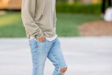 18 ripped blue jeans, a grey hoodie and beige suede boots