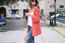 18 ripped blue skinnies, a white top, lace up blush shoes and a coral cardigan