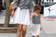 18 white skirts, suede boots and flats, a printed shirt for the mom and a striped shirt for the girl
