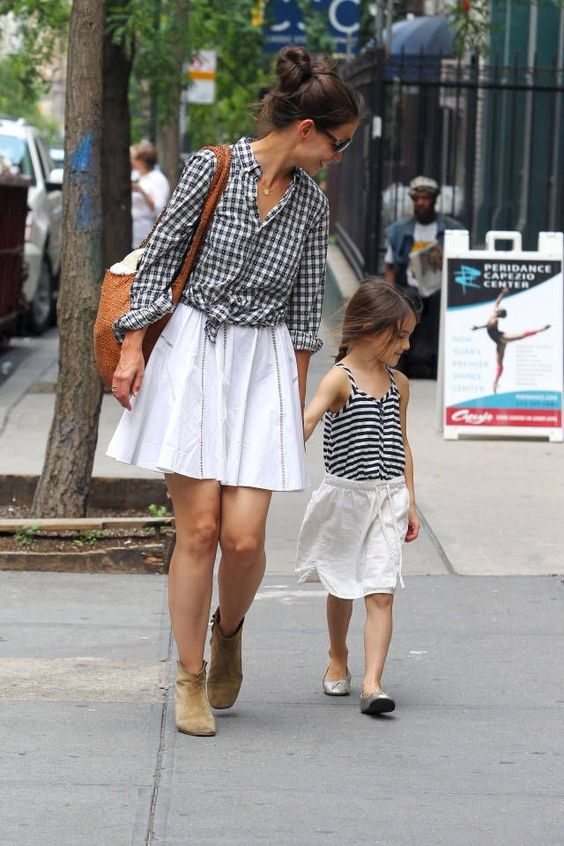 white skirts, suede boots and flats, a printed shirt for the mom and a striped shirt for the girl
