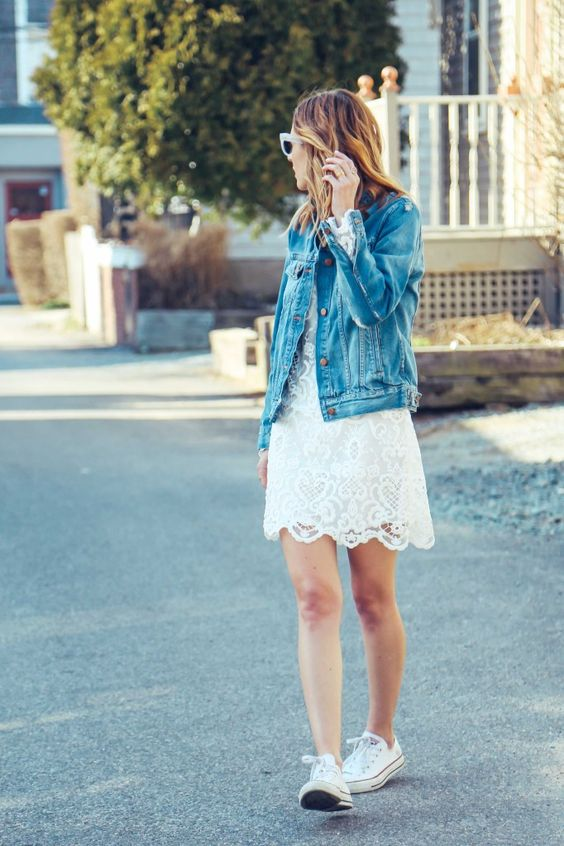 a white lace dress, white Converse and a denim jacket