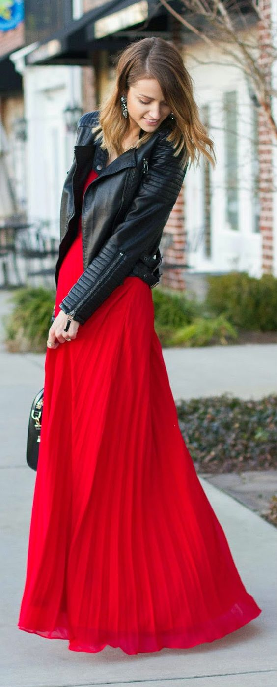 red pleated maxi dress and a black moto jacket