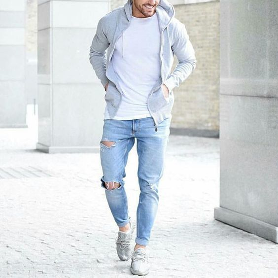 ripped blue jeans, a white tee, a grey hoodie and sneakers