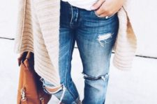 19 ripped blue jeans, a white tee, a neutral cardigan and sandals