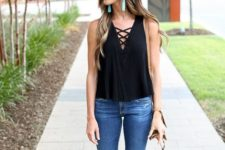 19 ripped denim, a black top and lace up sandals