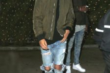 20 ripped blue jeans, suede boots, a black tee and an army green bomber jacket