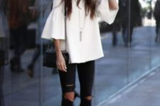 20 white ruffle sleeve and ripped black jeans