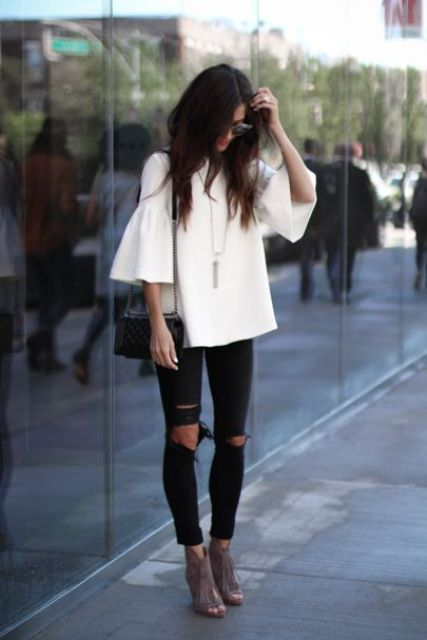 white ruffle sleeve and ripped black jeans