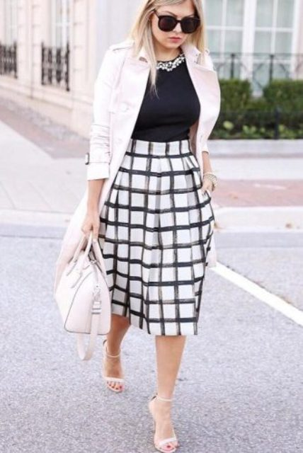 printed midi skirt, a black top with a statement necklace, a blush blazer and heels