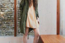 21 yellow mini dress, an army green parka, black Vans
