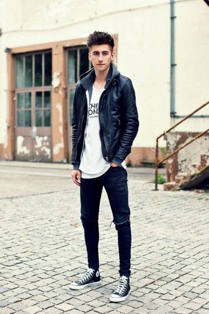 ripped jeans, a printed tee, black Converse and a leather jacket