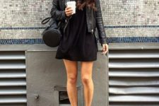 22 total black look with a mini dress, a leather jacket and Vans