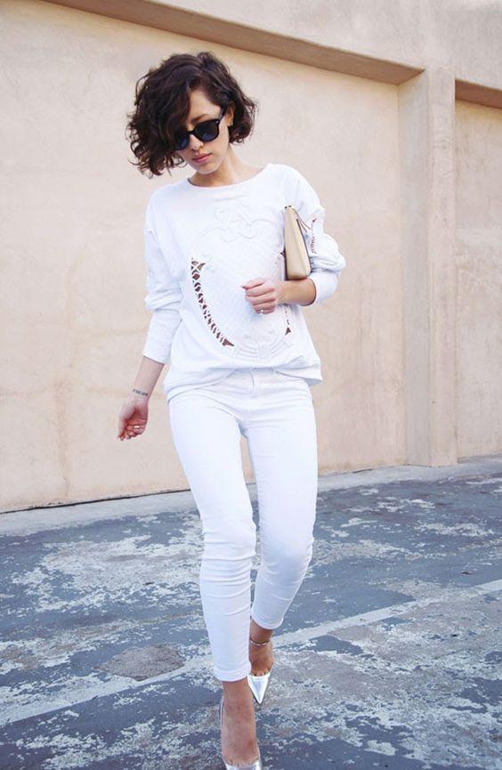 white jeans, a white sweatshirt and metallic shoes
