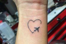 Airplane and heart tattoo