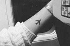 Black airplane tattoo