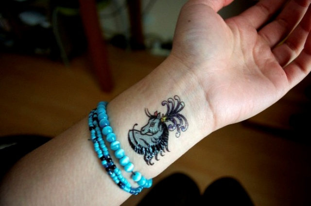 Blue horse tattoo on the wrist