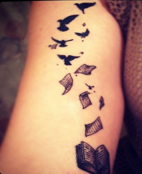 Book and birds tattoo