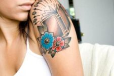 Book with flowers tattoo