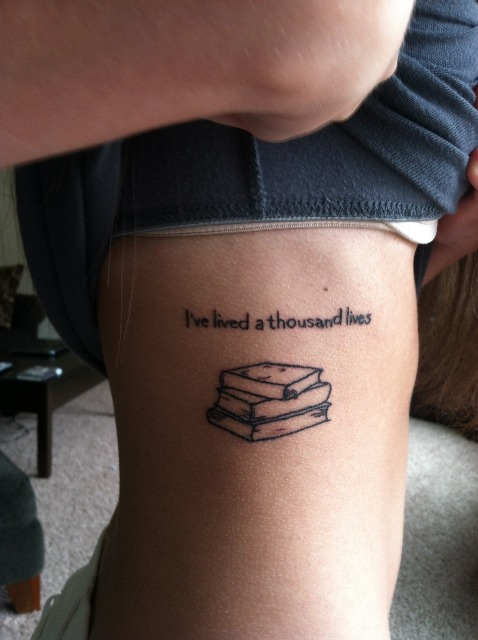 Book with phrase tattoo on the side