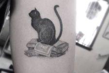 Books and cat tattoo idea