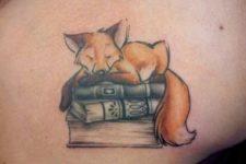 Books and fox tattoo