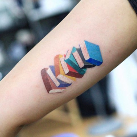 Colored books tattoo