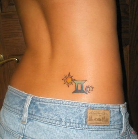 Colored sun with Zodiac sign tattoo