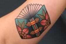Colorful book tattoo