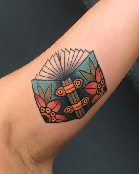 Colorful book tattoo