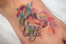 Colorful horse tattoo with phrase