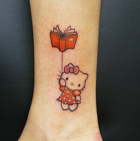 Hello Kitty with book tattoo