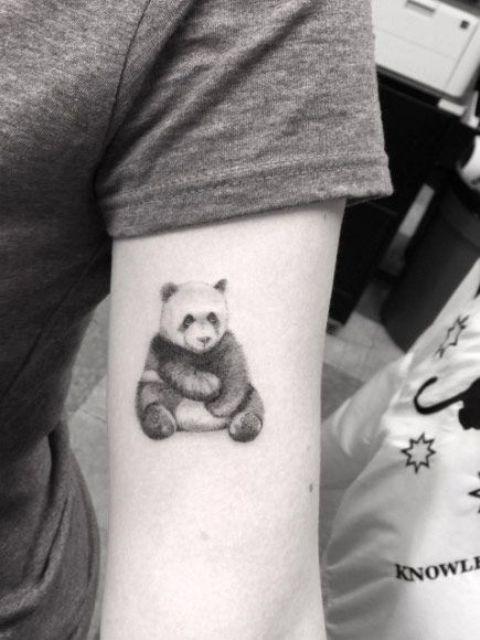 Panda tattoo on the arm