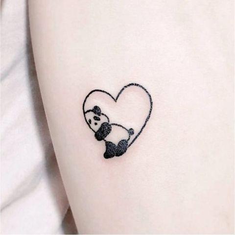 Panda with heart tattoo