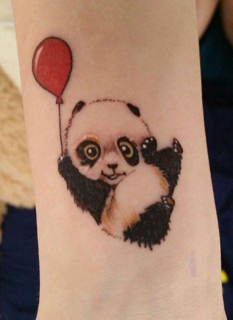 Panda with red balloon tattoo