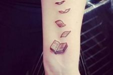 Unique book tattoo on the arm