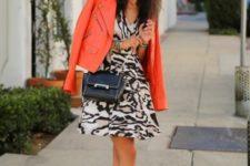 With animal print dress, crossbody bag and heels