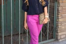With black blouse, beige shoes and bright clutch
