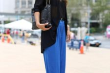 With black jacket, belt and leather bag