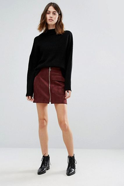 With black loose sweater and flat boots