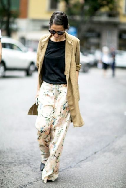With black shirt and beige long jacket