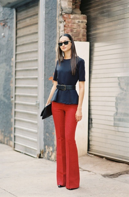 With black shirt, belt and clutch