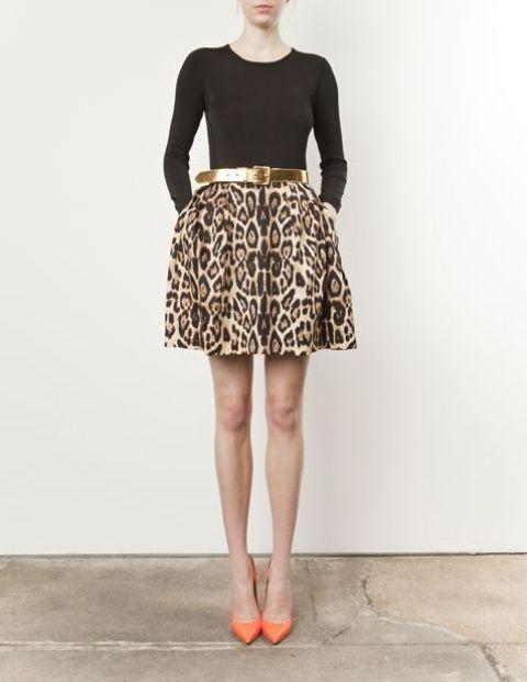 With black shirt, leopard skater skirt and golden belt