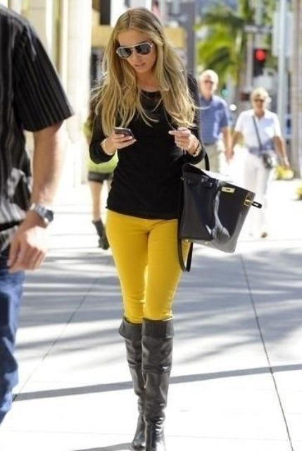 With black shirt, over the knee boots and bag