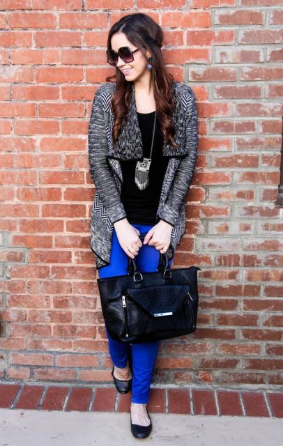 With black shirt, printed jacket and big bag