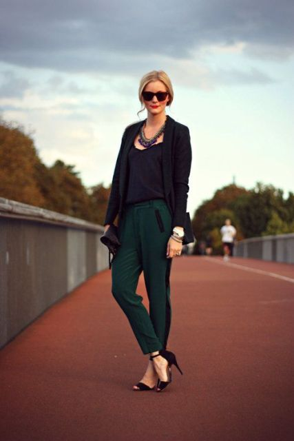 With black top, jacket and heels