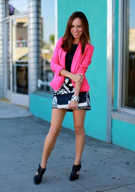With black top, printed mini skirt and two color clutch