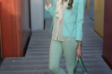 With blouse, mint pants and green bag