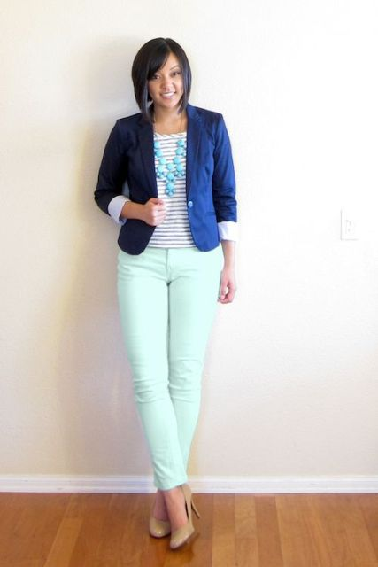 With blue blazer, neutral color shoes and statement necklace