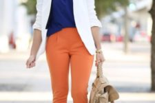 With blue blouse, white jacket, beige shoes and bag