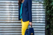 With blue jacket, bag and heels